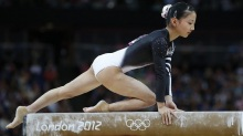 Japan's gymnast Asuka Teramoto performs on the vault during the women's qualification of the artistic gymnastics event of the London Olympic Games on July 29, 2012 at the 02 North Greenwich Arena in London. AFP PHOTO / THOMAS COEX