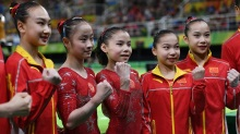 RIO DE JANEIRO, BRAZIL - AUGUST 07:  China Artistic Gymnastics Women's team pose for photographs after the Women's qualification for Artistic Gymnastics on Day 2 of the Rio 2016 Olympic Games at the Rio Olympic Arena on August 7, 2016 in Rio de Janeiro, Brazil.  (Photo by David Ramos/Getty Images)