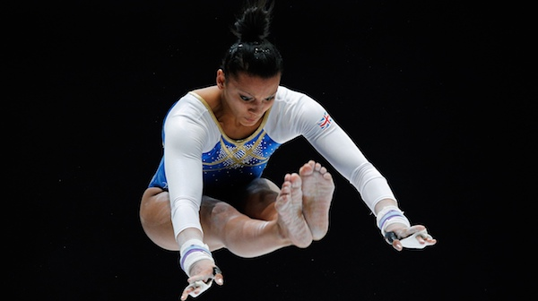 Becky Downie competes in the women's uneven bars at the Artistic Gymnastics World Championships